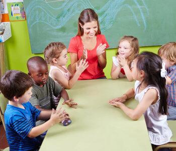 teacher and kids having fun